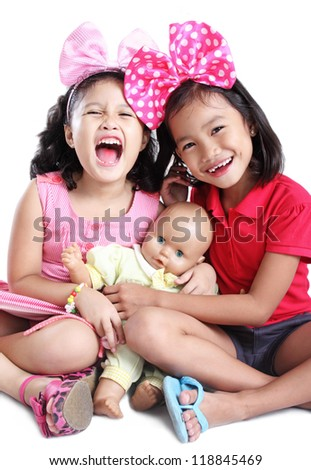 Happy young girls with big ribbons. - stock photo