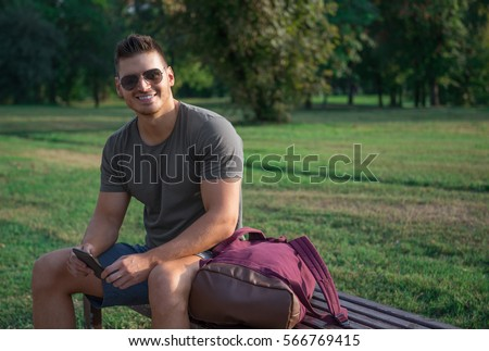 Happy, young, good looking guy enjoying in sunset