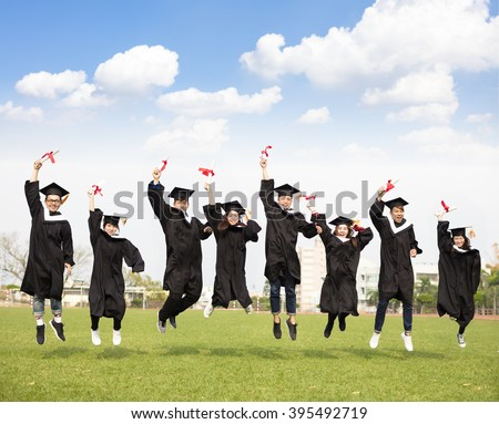 happy young group graduation jumping together  - stock photo