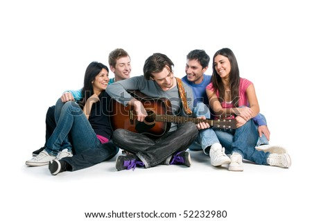 Happy young group of friends have fun and playing together the guitar isolated on white background - stock photo