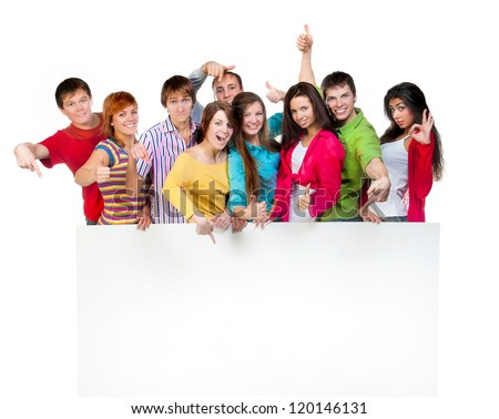 Happy young group of people standing together and holding a blank sign for your text - stock photo
