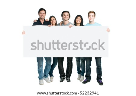 Happy young group of people standing together and holding a blank sign for your text, isolated on white background - stock photo