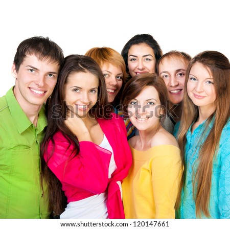 Happy young group of people standing together over white - stock photo