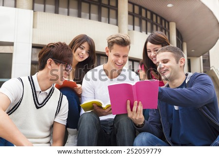 Happy  young group of students study together - stock photo