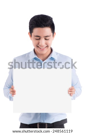 Happy young handsome asian man holding and showing blank paper or board ready for your text. Copy space. - stock photo