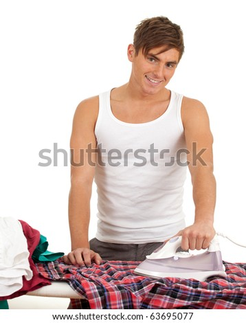 happy young handsome man ironing clothes, housework
