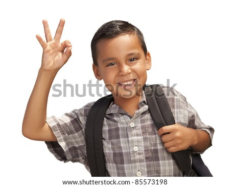 Happy Young Hispanic Boy Giving an Okay Hand Sign with Backpack Ready for School Isolated on a White Background. - stock photo