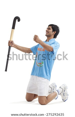 Happy young hockey player celebrating victory isolated over white background - stock photo