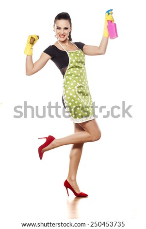 Happy young housewife posing on a white background - stock photo