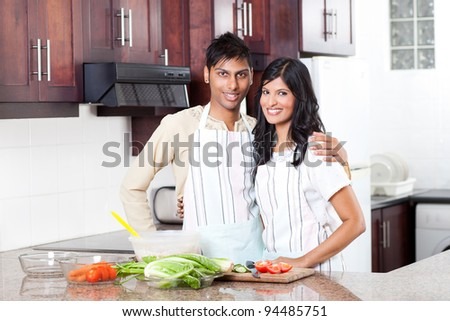 happy young indian couple portrait in kitchen - stock photo