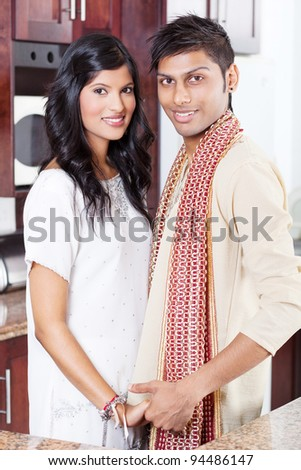 happy young indian couple portrait in traditional clothing - stock photo