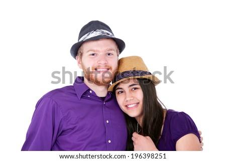 Happy young interracial couple in purple shirts, studio shot - stock photo