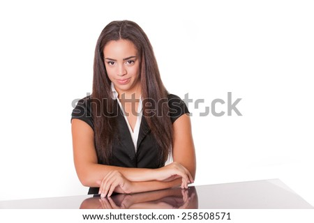 Happy young lady at desk, isolated on white