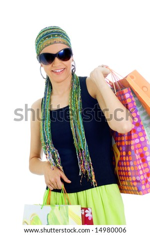 happy young lady holding shopping bags, isolated, on white background
