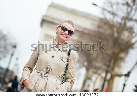 Happy young lady in Paris - stock photo
