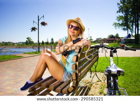 Happy young lady relaxing  after cycling - stock photo