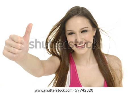 happy young lady showing thumb's up sign - stock photo