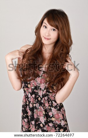 Happy young lady smiling, closeup portrait on gray studio background. - stock photo