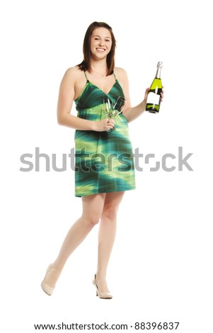 Happy young lady with champagne bottle in dress over white background