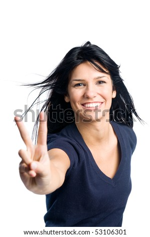 Happy young latin teenager girl showing victory sign isolated on white background - stock photo