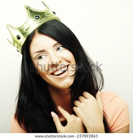happy young lovely brunette woman with crown  - stock photo