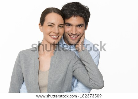 Happy young lover couple standing on white background, isolated - stock photo