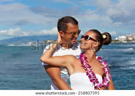 Happy young lovers enjoying every moment together. Beautiful couple in love. Couple in love, summer luxury vacation in Hawaii. Travel holidays concept. Living, loving and laughing - stock photo