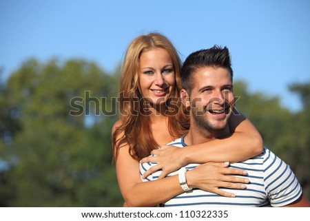 Happy young lovers having fun in the park