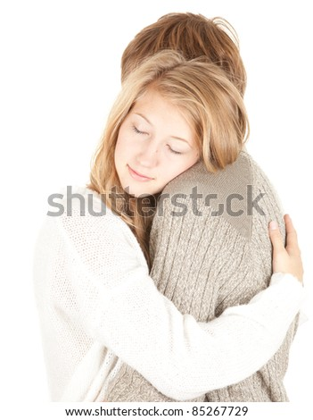 happy young loving couple embracing, white background - stock photo