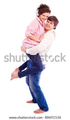 happy young loving couple, isolated against white background