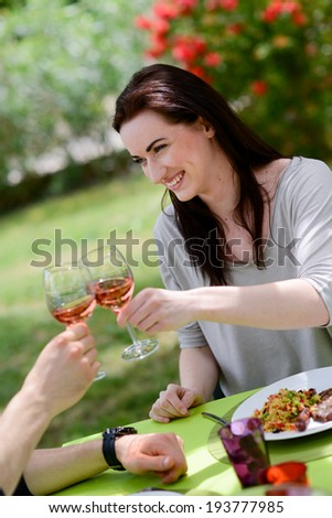 happy young loving woman cheering with a friend at lunch barbecue party outdoor in the garden - stock photo