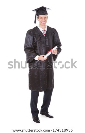 Happy Young Male Graduate Isolated Over White Background