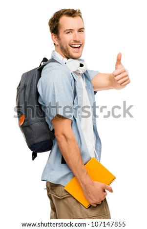 Happy young male student giving thumbs up sign on white background - stock photo