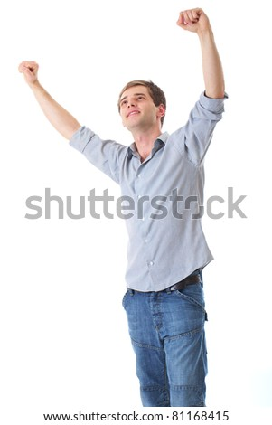 happy young male with his arms up in victory gesture, isolated - stock photo