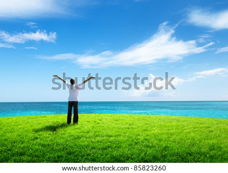 happy young man and sea - stock photo