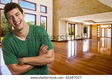 Happy young man at home - stock photo