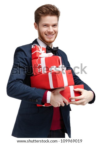 Happy young man carries a lot of presents, isolated on white - stock photo