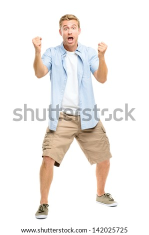 happy young man celebrating success on white background - stock photo