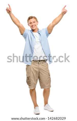 Happy young man celebrating with arms up isolated on white background - stock photo