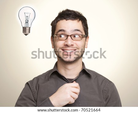 Happy young man coming up with an idea or solution - stock photo