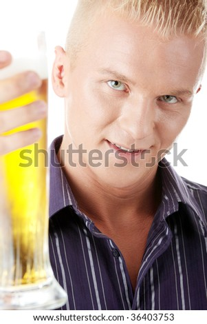 Happy young man holding a glass of beer isolated - stock photo