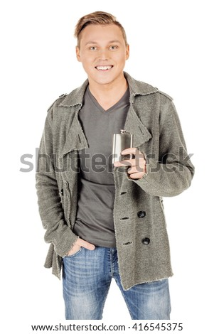 happy young man holding alcohol flask