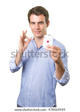 Happy young man holding an ace of hearts on white background
