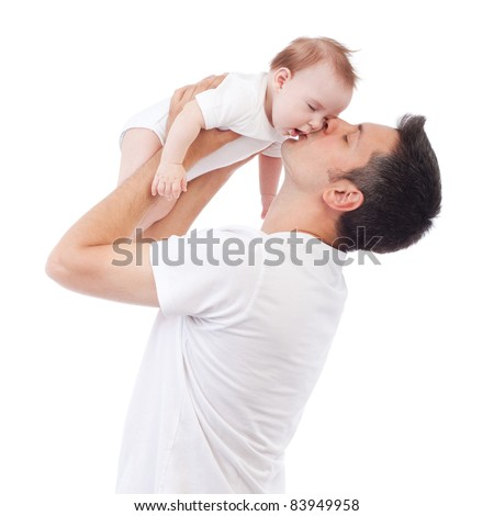 Happy young man holding and kissing a 4-5 months old baby, isolated on white