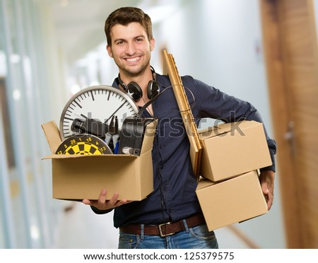 Happy Young Man Holding Cardboxes, Indoor - stock photo