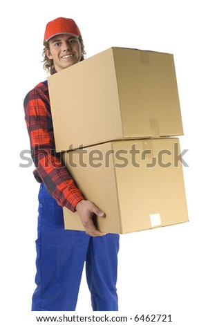 Happy young man holding two boxes. Isolated on white background - stock photo