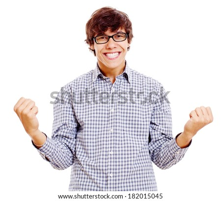 Happy young man in black glasses with raised fists isolated on white background - stock photo