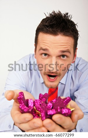 Happy young man in shirt and tie is surprised from Christmas stars. - stock photo