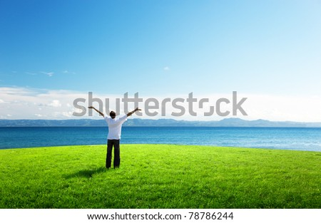 happy young man in sunset time and sea - stock photo