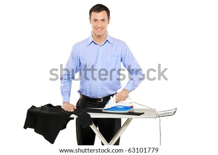 Happy young man ironing his clothes isolated against white background - stock photo